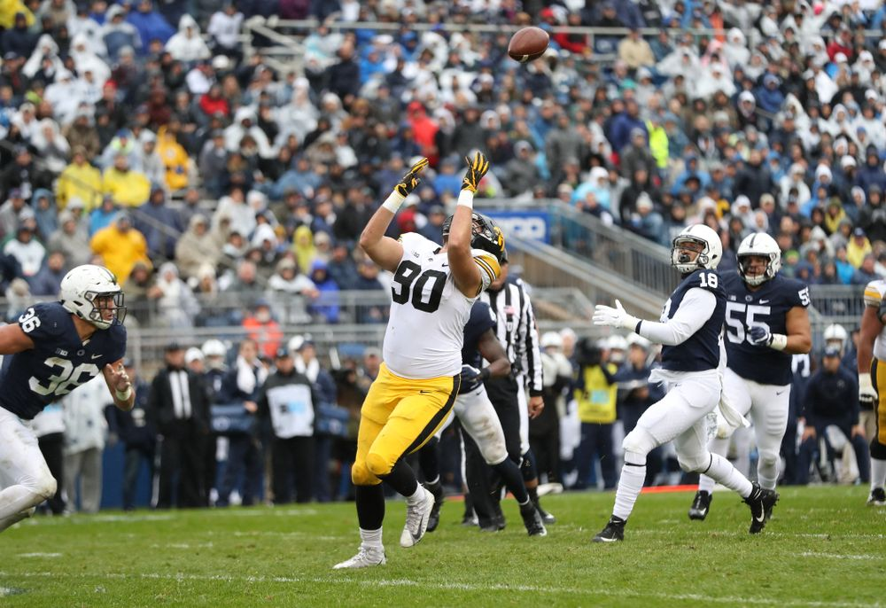 Iowa Hawkeyes defensive end Sam Brincks (90) catches a touchdown pass against the Penn State Nittany Lions Saturday, October 27, 2018 at Beaver Stadium in University Park, Pa. (Max Allen/hawkeyesports.com)