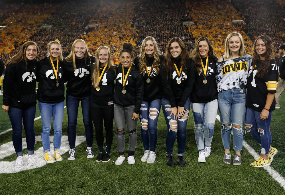 Members of the Iowa softball team are recognized by the Presidential Committee on Athletics at halftime during a game against Wisconsin on September 22, 2018. (Tork Mason/hawkeyesports.com)
