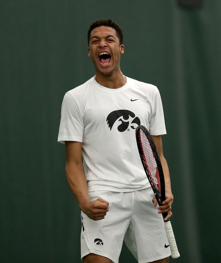 Iowa's Will Davies and Oliver Okonkwo celebrates a point against Cornell Sunday, March 8, 2020 at the Hawkeye Tennis and Recreation Center. (Brian Ray/hawkeyesports.com)
