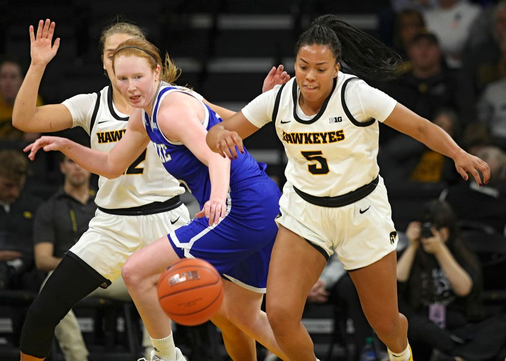 Iowa Hawkeyes guard Alexis Sevillian (5) steals the ball away during the third quarter of their game at Carver-Hawkeye Arena in Iowa City on Saturday, December 21, 2019. (Stephen Mally/hawkeyesports.com)