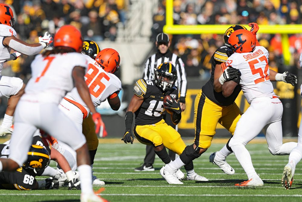 Iowa Hawkeyes running back Tyler Goodson (15) makes a cut on a run during the first quarter of their game at Kinnick Stadium in Iowa City on Saturday, Nov 23, 2019. (Stephen Mally/hawkeyesports.com)