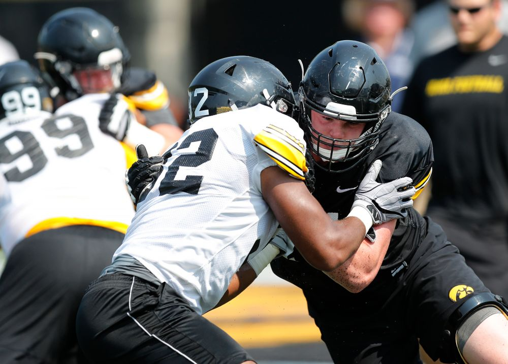 Iowa Hawkeyes offensive lineman Mark Kallenberger (71) and linebacker Djimon Colbert (32) during fall camp practice No. 9 Friday, August 10, 2018 at the Kenyon Practice Facility. (Brian Ray/hawkeyesports.com)