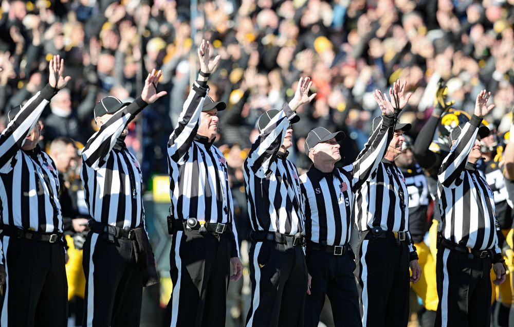 Officials wave to the University of Iowa Stead Family Children's Hospital between the first and second quarter of their game at Kinnick Stadium in Iowa City on Saturday, Nov 23, 2019. (Stephen Mally/hawkeyesports.com)