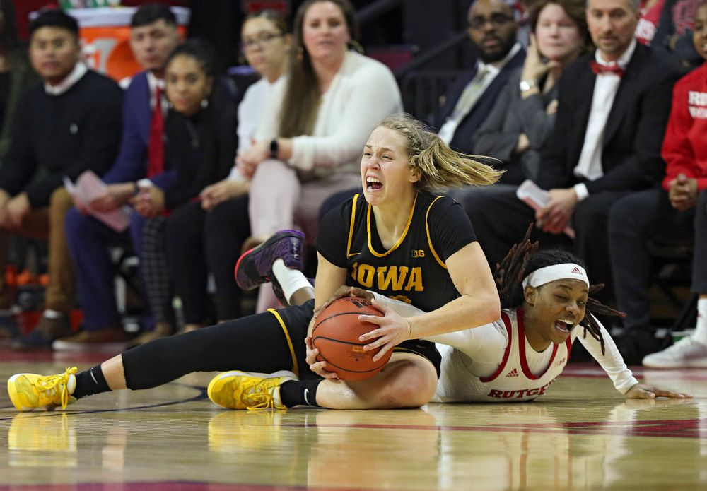 Iowa guard Kathleen Doyle (22) grabs a loose ball on the court during the fourth quarter of their game at the Rutgers Athletic Center in Piscataway, N.J. on Sunday, March 1, 2020. (Stephen Mally/hawkeyesports.com)