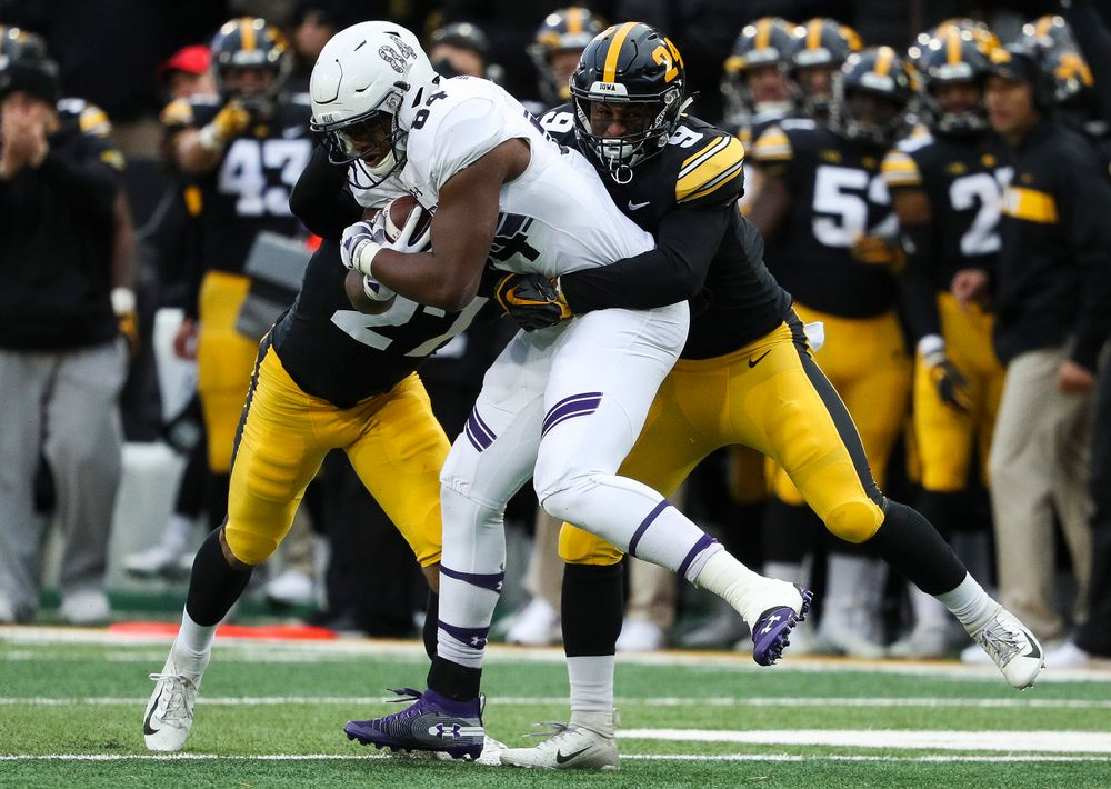 Iowa Hawkeyes defensive back Geno Stone (9) makes a tackle during a game against Northwestern at Kinnick Stadium on November 10, 2018. (Tork Mason/hawkeyesports.com)
