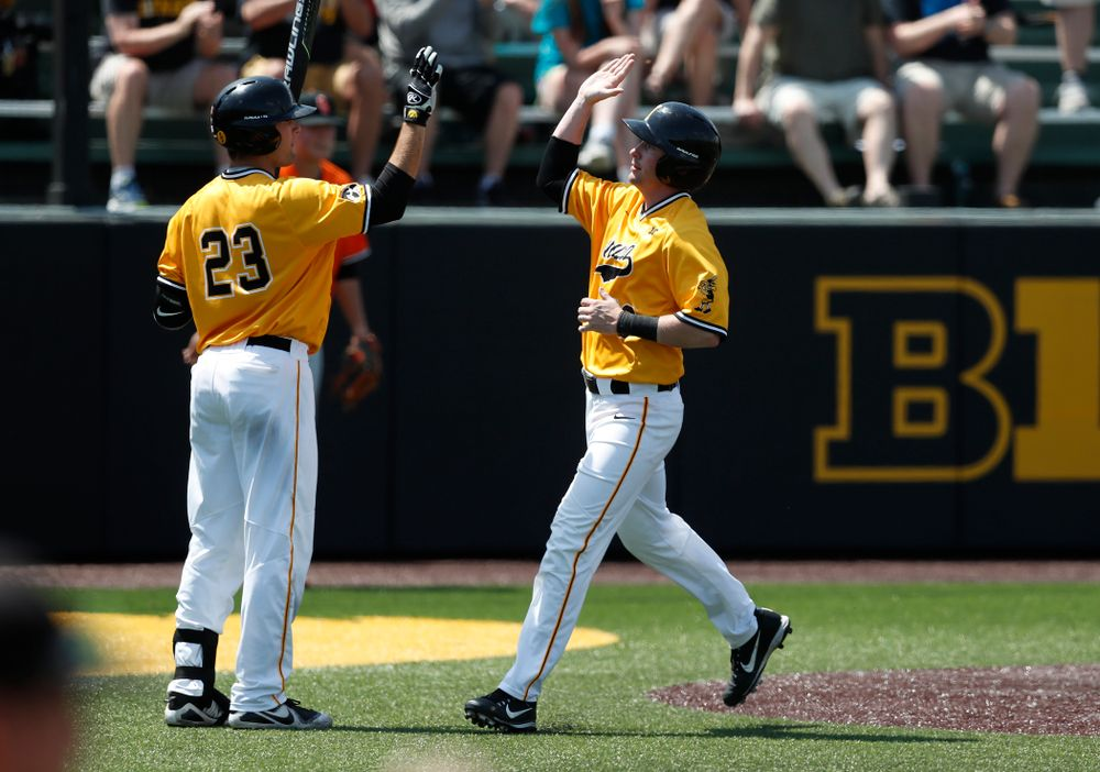 Iowa Hawkeyes infielder Chris Whelan (28) high fives infielder Kyle Crowl (23) after scoring against the Oklahoma State Cowboys Sunday, May 6, 2018 at Duane Banks Field. (Brian Ray/hawkeyesports.com)