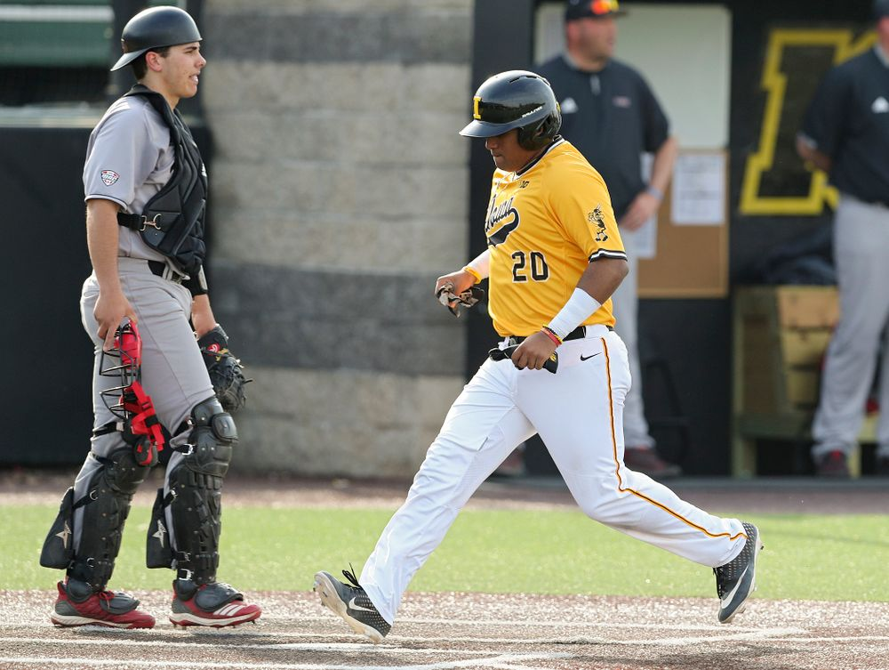 Iowa Hawkeyes first baseman Izaya Fullard (20) scores a run during the third inning of their game against Northern Illinois at Duane Banks Field in Iowa City on Tuesday, Apr. 16, 2019. (Stephen Mally/hawkeyesports.com)