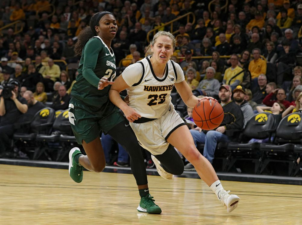 Iowa Hawkeyes guard Kathleen Doyle (22) drives with the ball during the first quarter of their game at Carver-Hawkeye Arena in Iowa City on Sunday, January 26, 2020. (Stephen Mally/hawkeyesports.com)