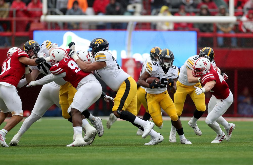 Iowa Hawkeyes running back Tyler Goodson (15) gets a block from offensive lineman Alaric Jackson (77) on his way to a touchdown against the Nebraska Cornhuskers Friday, November 29, 2019 at Memorial Stadium in Lincoln, Neb. (Brian Ray/hawkeyesports.com)
