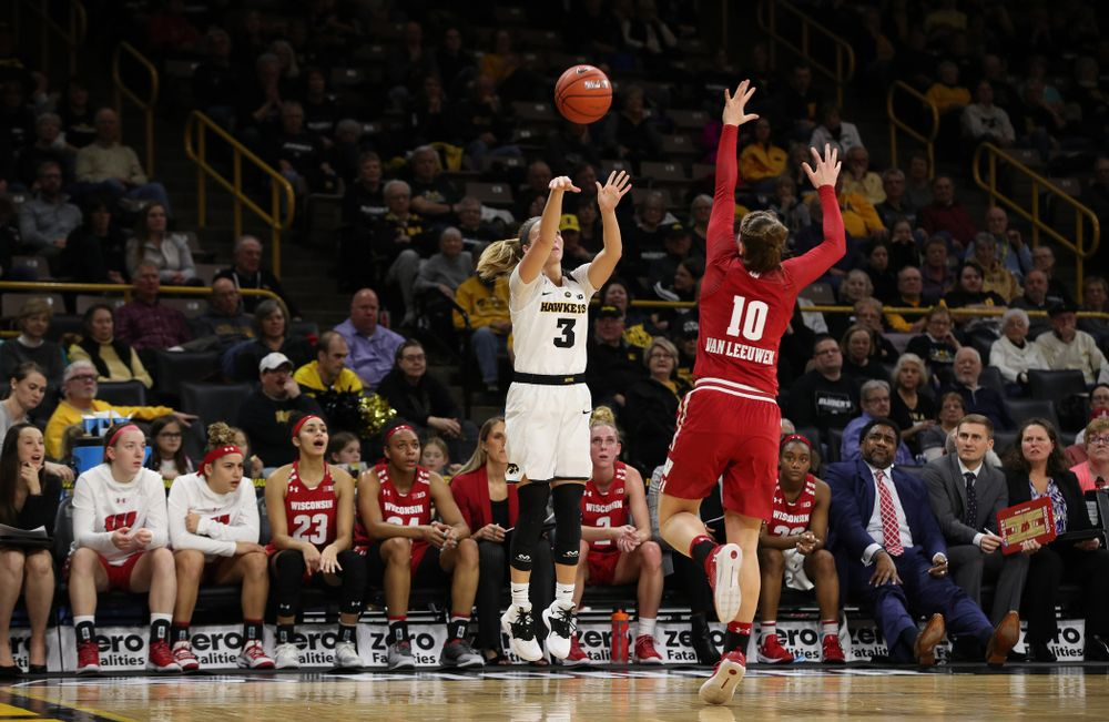 Iowa Hawkeyes guard Makenzie Meyer (3) knocks down a three point basket against the Wisconsin Badgers Monday, January 7, 2019 at Carver-Hawkeye Arena.  (Brian Ray/hawkeyesports.com)