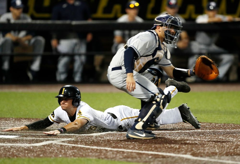 Iowa Hawkeyes outfielder Ben Norman (9) scores against the Penn State Nittany Lions  Thursday, May 17, 2018 at Duane Banks Field. (Brian Ray/hawkeyesports.com)