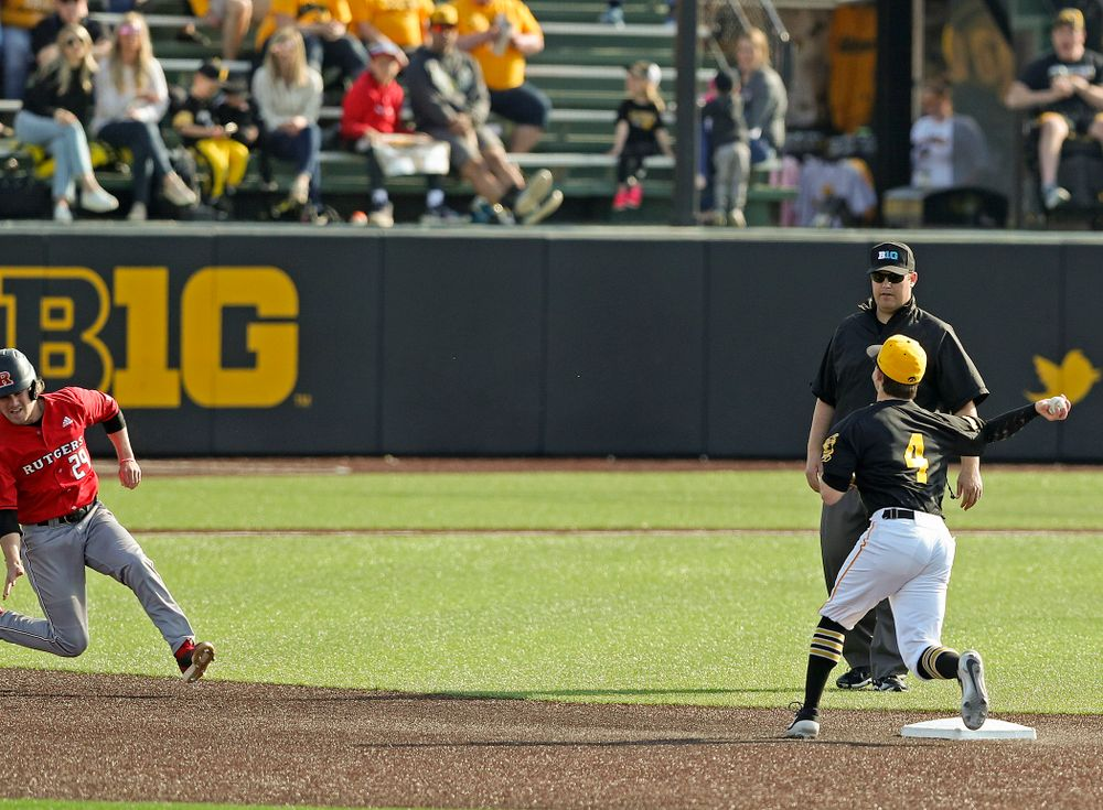 Iowa Hawkeyes second baseman Mitchell Boe (4) throws to first base as they turn a double play during the eighth inning of their game against Rutgers at Duane Banks Field in Iowa City on Saturday, Apr. 6, 2019. (Stephen Mally/hawkeyesports.com)