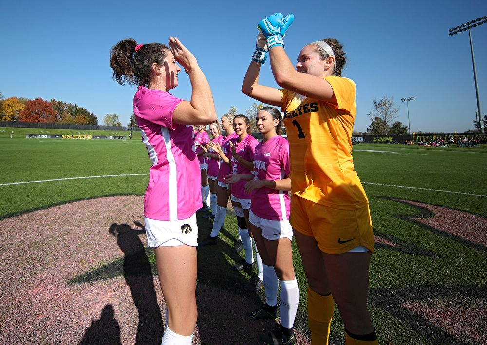 Iowa forward Devin Burns (30) high-fives goalkeeper Claire Graves (1) on the field before their match at the Iowa Soccer Complex in Iowa City on Sunday, Oct 27, 2019. (Stephen Mally/hawkeyesports.com)