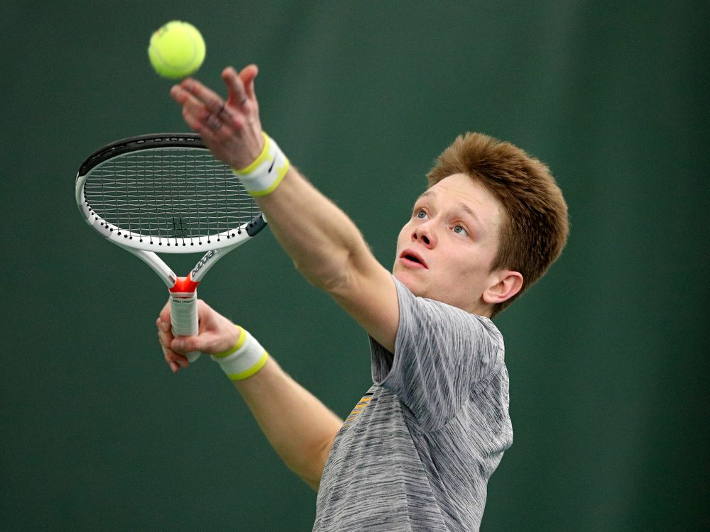 Iowa's Jason Kerst serves during their match at the Hawkeye Tennis and Recreation Complex in Iowa City on Thursday, January 16, 2020. (Stephen Mally/hawkeyesports.com)