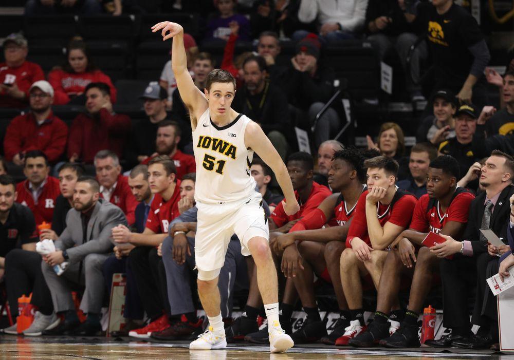 Iowa Hawkeyes forward Nicholas Baer (51) knocks down a three point basket against the Rutgers Scarlet Knights  Saturday, March 2, 2019 at Carver-Hawkeye Arena. (Brian Ray/hawkeyesports.com)