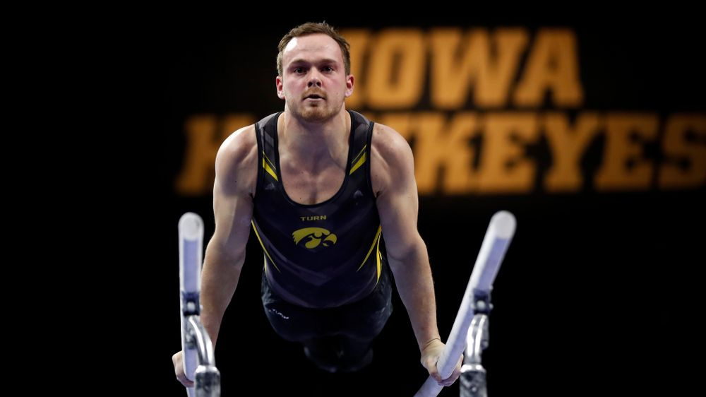 Iowa's Dylan Ellsworth competes on the bars