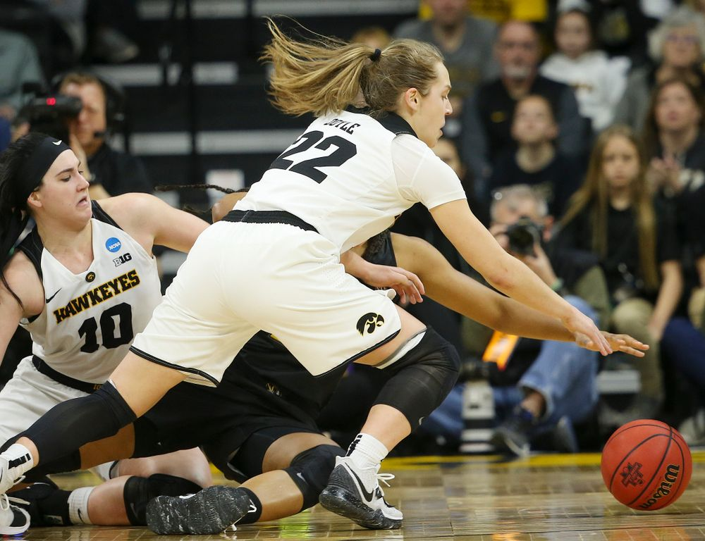 Iowa Hawkeyes guard Kathleen Doyle (22) tries to grab a loose ball during the third quarter of their second round game in the 2019 NCAA Women's Basketball Tournament at Carver Hawkeye Arena in Iowa City on Sunday, Mar. 24, 2019. (Stephen Mally for hawkeyesports.com)