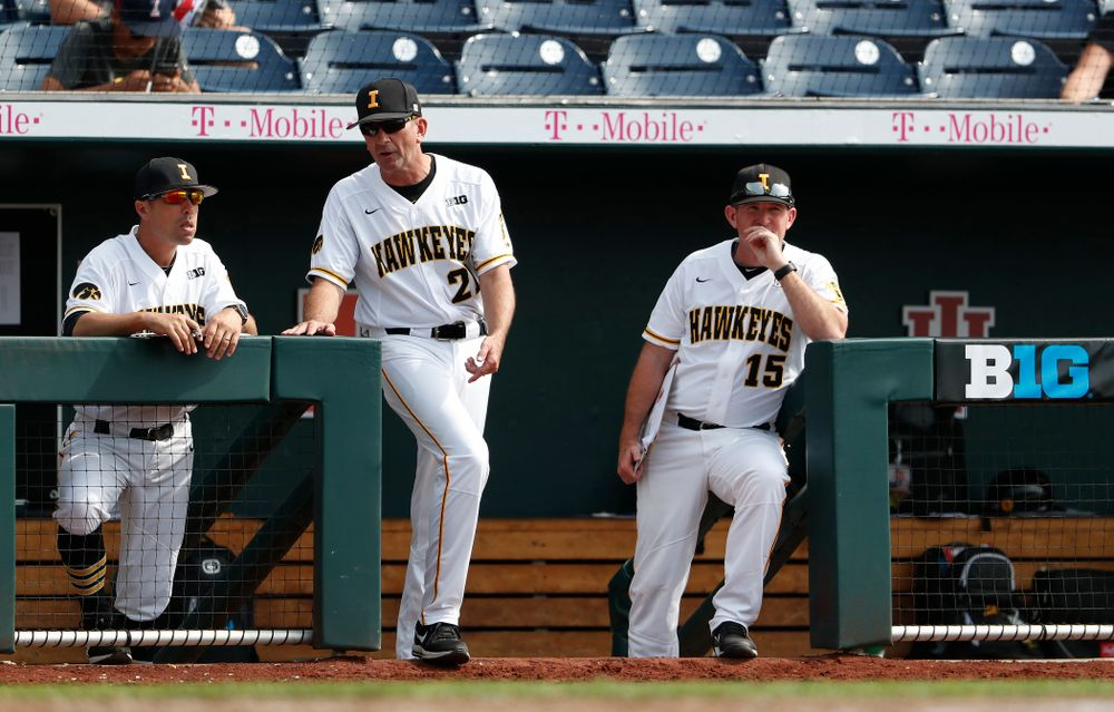 Iowa Hawkeyes head coach Rick Heller, associate head coach Marty Sutherland, and pitching coach Desi Druschel against the Ohio State Buckeyes in the second round of the Big Ten Baseball tTournament  Thursday, May 24, 2018 at TD Ameritrade Park in Omaha, Neb. (Brian Ray/hawkeyesports.com)