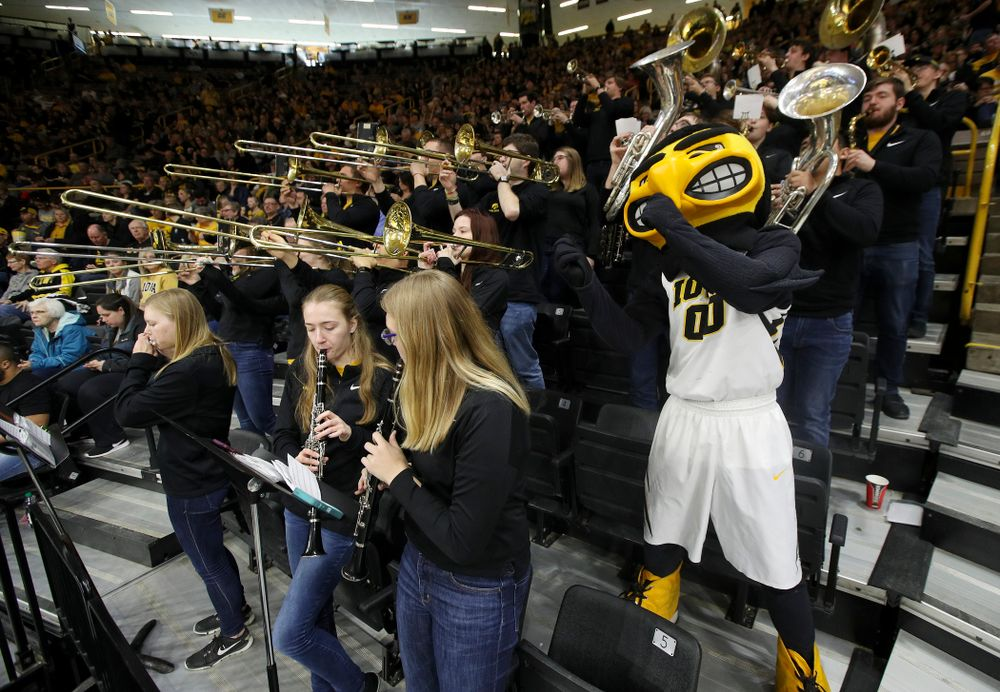 Herky plays with the band during halftime of their second round game in the 2019 NCAA Women's Basketball Tournament at Carver Hawkeye Arena in Iowa City on Sunday, Mar. 24, 2019. (Stephen Mally for hawkeyesports.com)