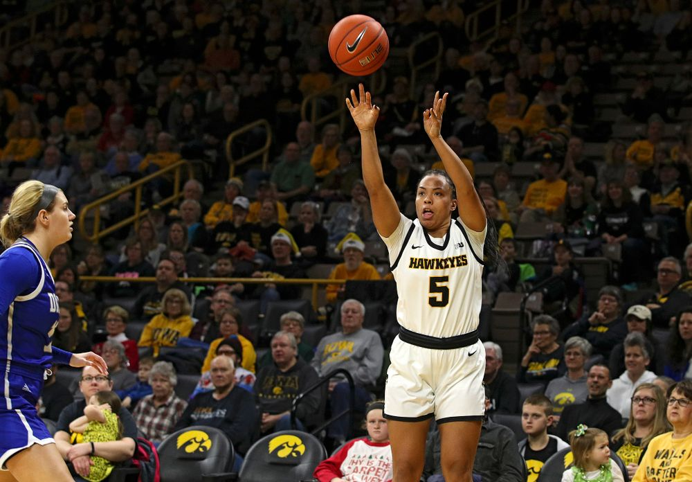 Iowa Hawkeyes guard Alexis Sevillian (5) makes a 3-pointer during the first quarter of their game at Carver-Hawkeye Arena in Iowa City on Saturday, December 21, 2019. (Stephen Mally/hawkeyesports.com)