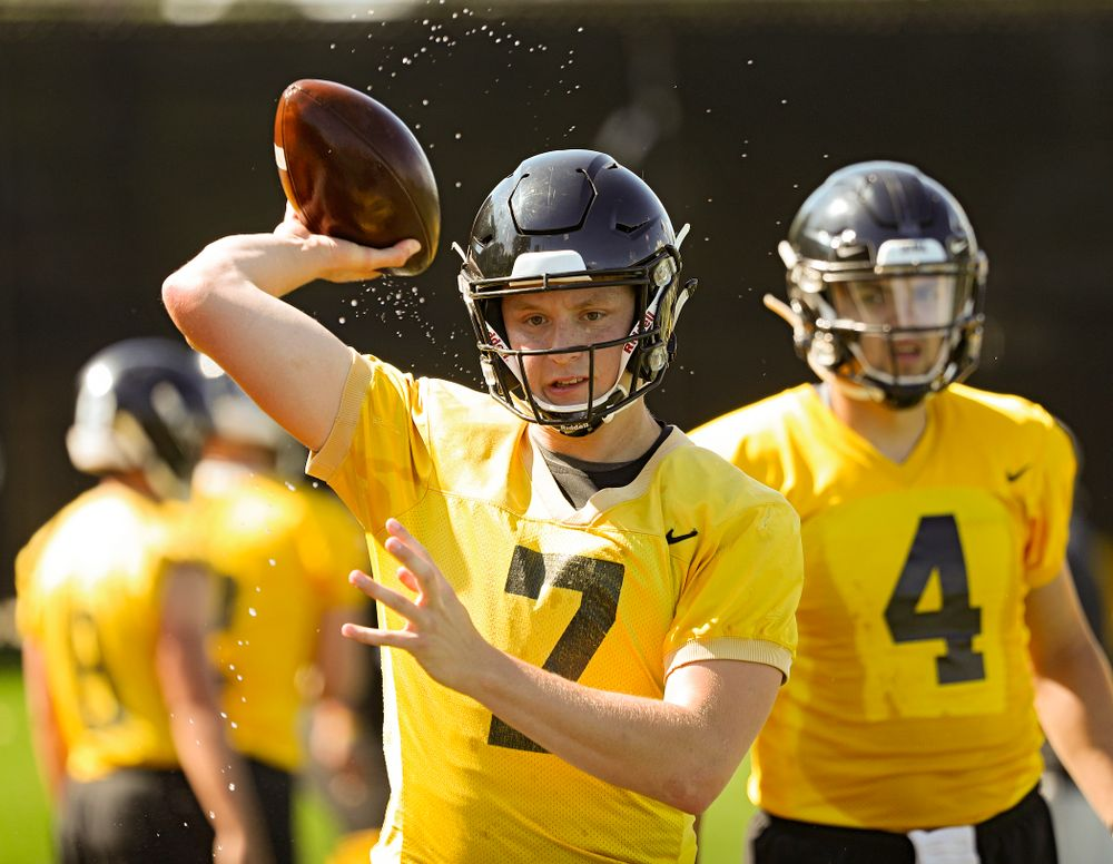 Iowa Hawkeyes quarterback Spencer Petras (7) throws a wet football as they run a drill during Fall Camp Practice No. 13 at the Hansen Football Performance Center in Iowa City on Friday, Aug 16, 2019. (Stephen Mally/hawkeyesports.com)