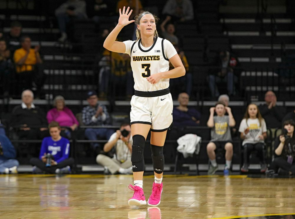Iowa Hawkeyes guard Makenzie Meyer (3) holds up her hand as she calls a play during the first quarter of their game at Carver-Hawkeye Arena in Iowa City on Saturday, December 21, 2019. (Stephen Mally/hawkeyesports.com)