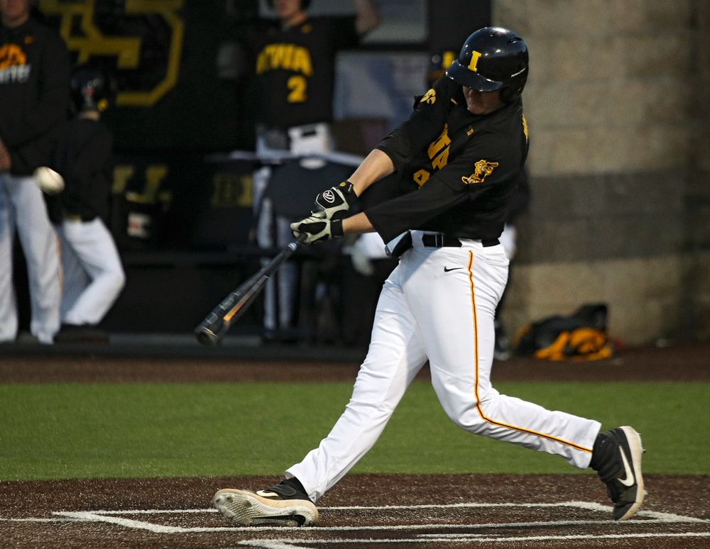 Iowa first baseman Peyton Williams (45) hits a triple during the sixth inning of their game at Duane Banks Field in Iowa City on Tuesday, March 3, 2020. (Stephen Mally/hawkeyesports.com)