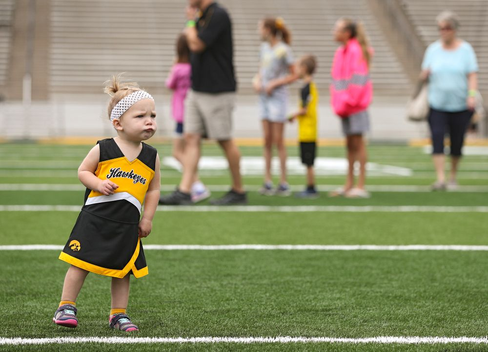 A young fan walks on the field as Junior Hawk Club members participate in the Swarm Experience during Kids Day at Kinnick Stadium in Iowa City on Saturday, Aug 10, 2019. (Stephen Mally/hawkeyesports.com)