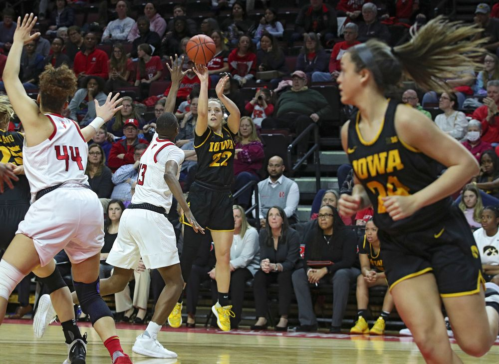 Iowa guard Kathleen Doyle (22) makes a 3-pointer during the fourth quarter of their game at the Rutgers Athletic Center in Piscataway, N.J. on Sunday, March 1, 2020. (Stephen Mally/hawkeyesports.com)