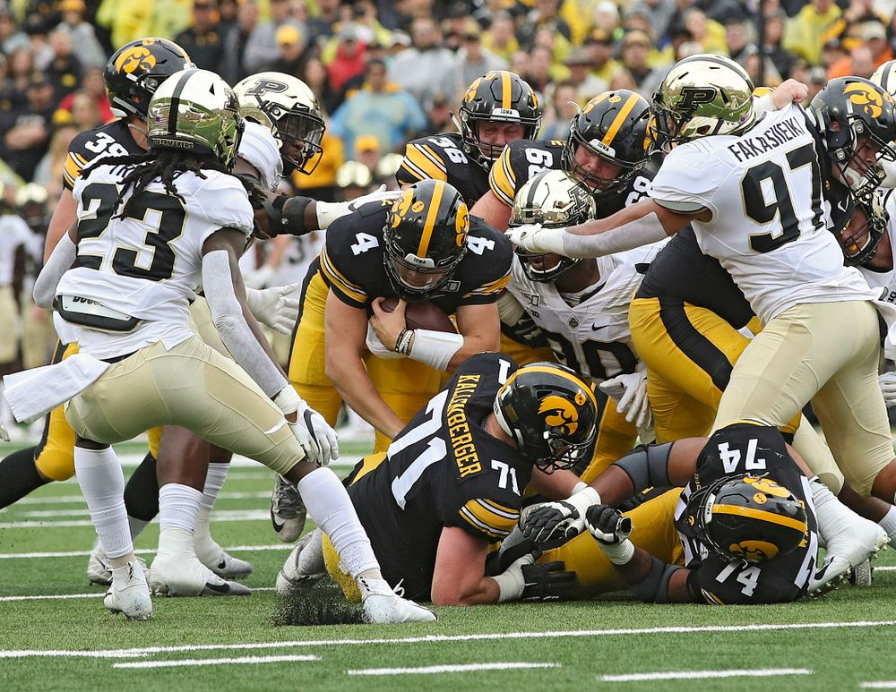 Iowa Hawkeyes quarterback Nate Stanley (4) dives ahead for yards on a run during the first quarter of their game at Kinnick Stadium in Iowa City on Saturday, Oct 19, 2019. (Stephen Mally/hawkeyesports.com)