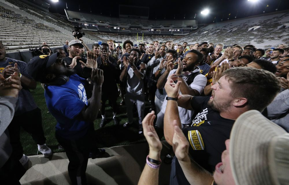Members of the Iowa Football Team sing the ÒFight SongÓ  Thursday, August 22, 2019 at Kinnick Stadium in Iowa City. (Brian Ray/hawkeyesports.com)