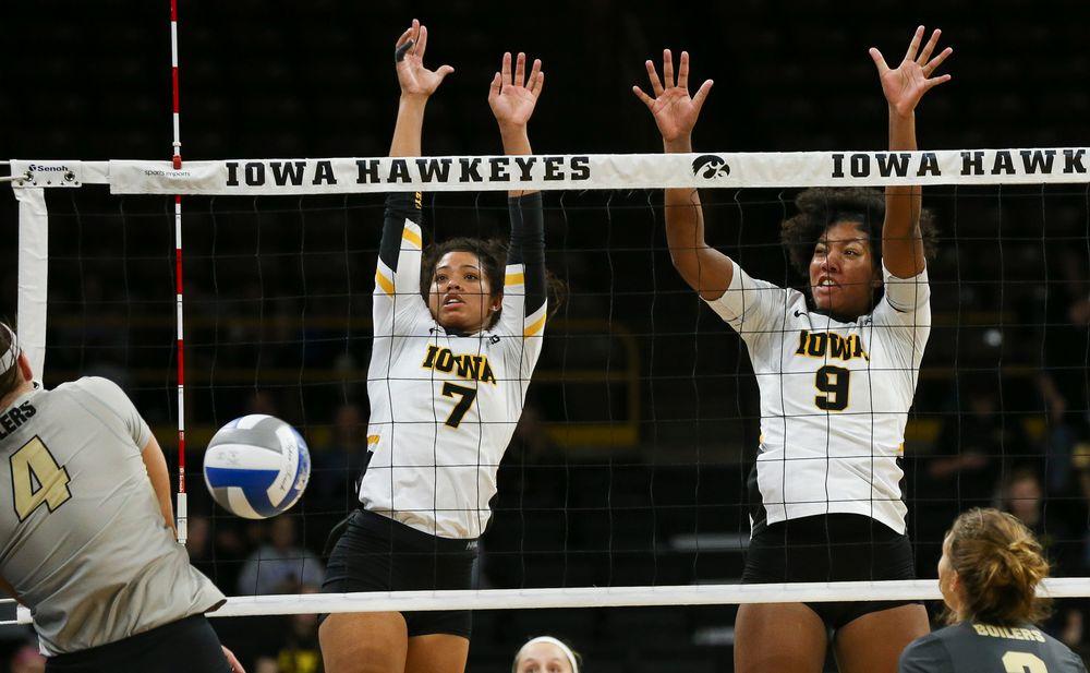 Iowa Hawkeyes setter Brie Orr (7) and Iowa Hawkeyes middle blocker Amiya Jones (9) block an attack during a game against Purdue at Carver-Hawkeye Arena on October 13, 2018. (Tork Mason/hawkeyesports.com)