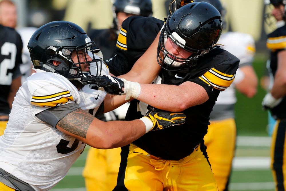 Iowa Hawkeyes defensive end A.J. Epenesa (94) and offensive lineman Mark Kallenberger (71) during camp practice No. 16 Tuesday, August 21, 2018 at the Hansen Football Performance Center. (Brian Ray/hawkeyesports.com)