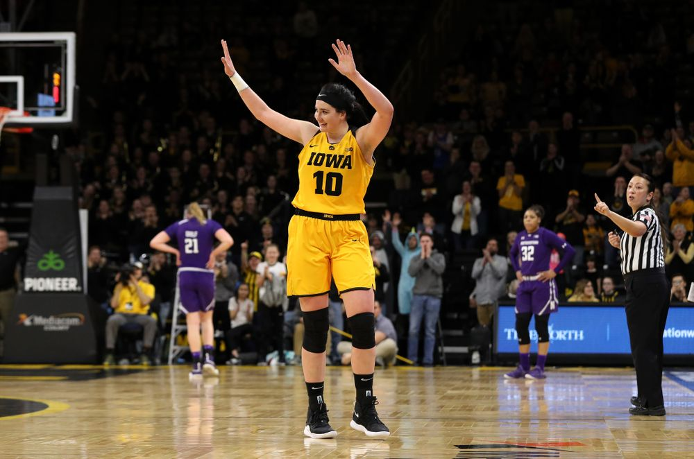Iowa Hawkeyes forward Megan Gustafson (10) waves to the fans as she lives the court for the final time against the Northwestern Wildcats Sunday, March 3, 2019 at Carver-Hawkeye Arena. (Brian Ray/hawkeyesports.com)