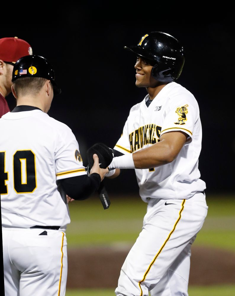 Iowa Hawkeyes third baseman Lorenzo Elion (1) smiles after singling to complete hitting for the cycle against Coe College Wednesday, April 11, 2018 at Duane Banks Field. (Brian Ray/hawkeyesports.com)