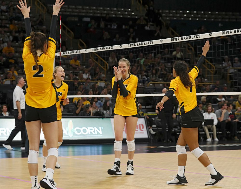 Iowa's Courtney Buzzerio (2), Kyndra Hansen (8), Hannah Clayton (18), and Brie Orr (7) celebrate a score during their match at Carver-Hawkeye Arena in Iowa City on Sunday, Oct 20, 2019. (Stephen Mally/hawkeyesports.com)