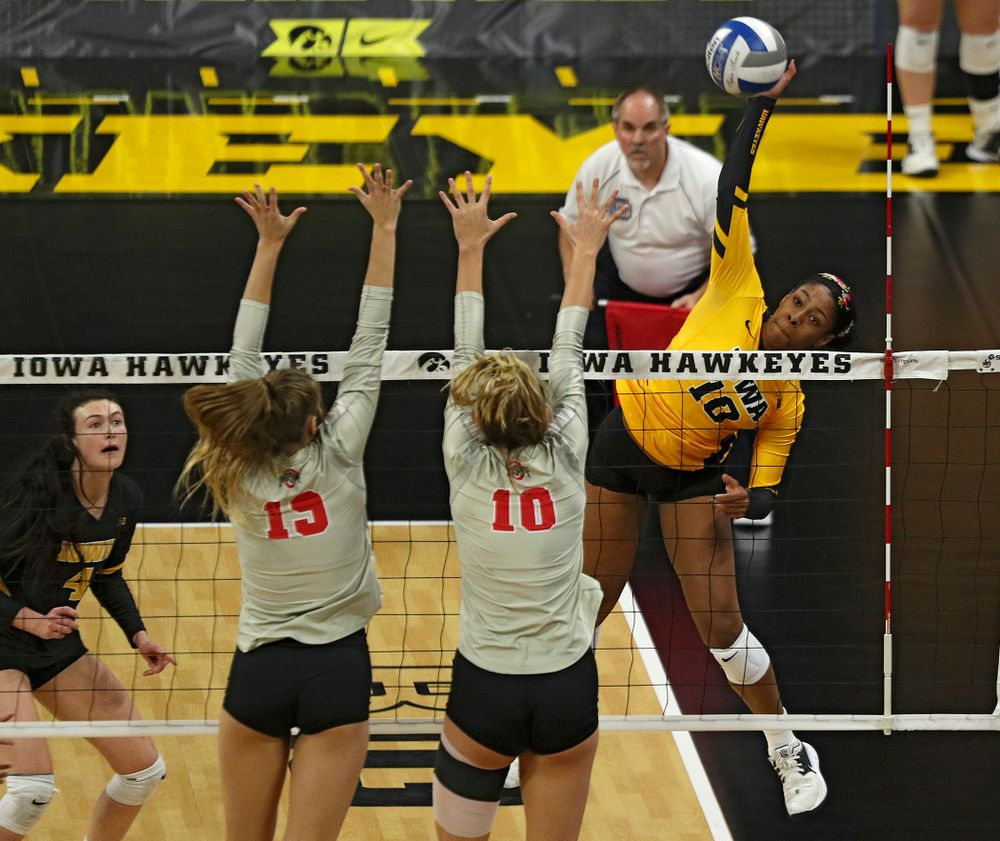 Iowa's Griere Hughes (10) gets up for a kill during the second set of their match at Carver-Hawkeye Arena in Iowa City on Friday, Nov 29, 2019. (Stephen Mally/hawkeyesports.com)