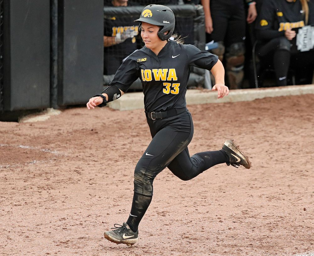 Iowa's Riley Sheehy (33) scores a run during the sixth inning of their game against Iowa Softball vs Indian Hills Community College at Pearl Field in Iowa City on Sunday, Oct 6, 2019. (Stephen Mally/hawkeyesports.com)