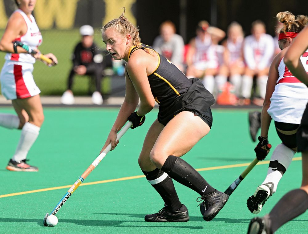 Iowa's Katie Birch (11) spins with the ball during the first quarter of their match at Grant Field in Iowa City on Friday, Oct 4, 2019. (Stephen Mally/hawkeyesports.com)
