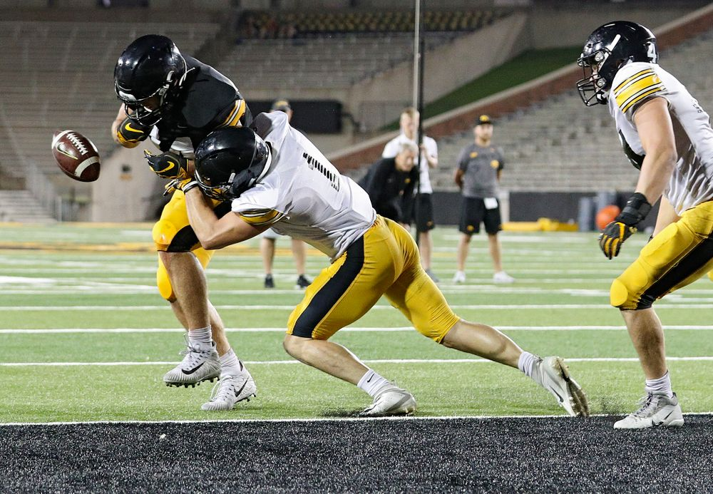 Iowa Hawkeyes defensive back Wes Dvorak (1) separates tight end Sam LaPorta (84) from the ball during Fall Camp Practice No. 12 at Kinnick Stadium in Iowa City on Thursday, Aug 15, 2019. (Stephen Mally/hawkeyesports.com)