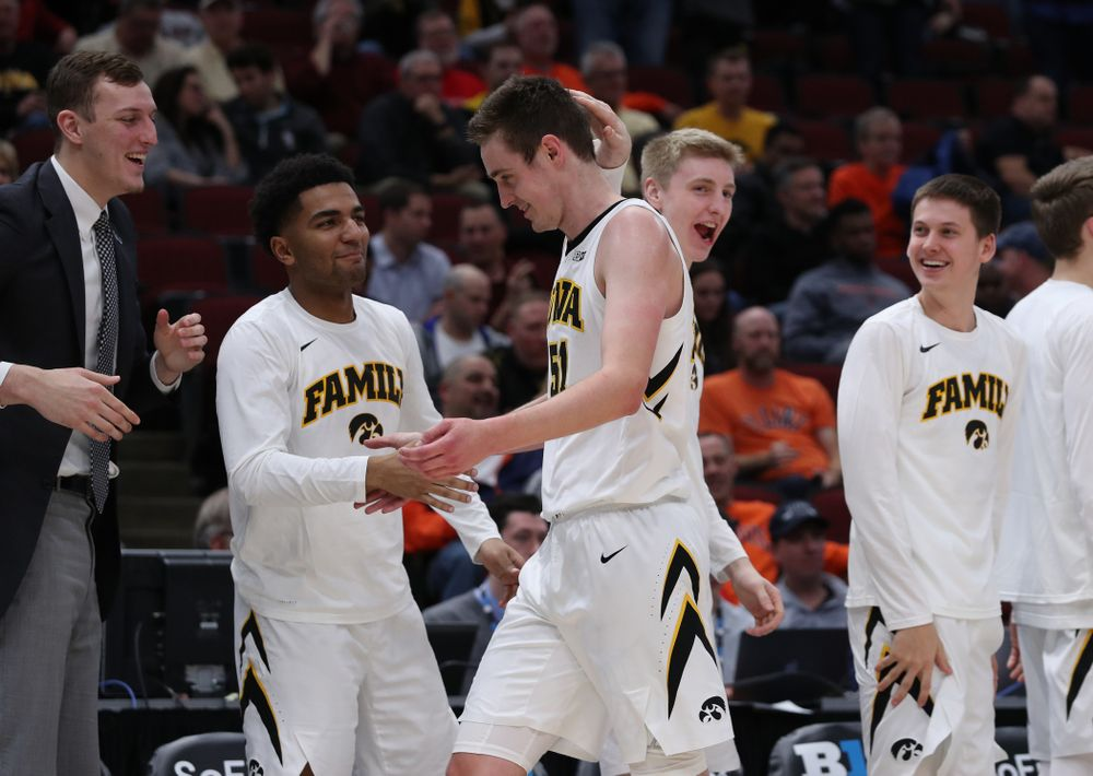 Iowa Hawkeyes forward Nicholas Baer (51) and forward Michael Baer (0) against the Illinois Fighting Illini in the 2019 Big Ten Men's Basketball Tournament Thursday, March 14, 2019 at the United Center in Chicago. (Brian Ray/hawkeyesports.com)
