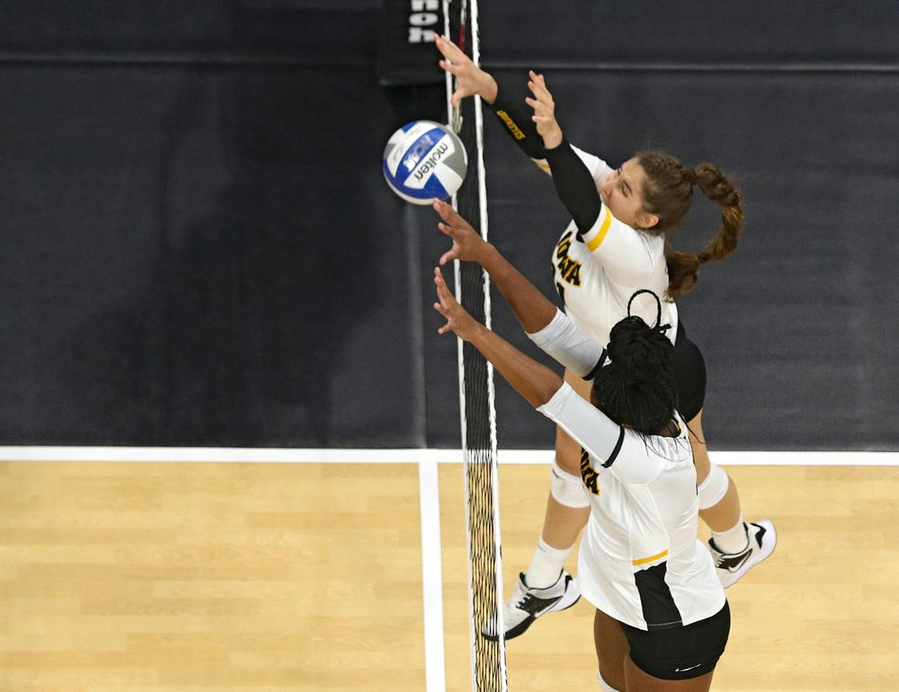 Iowa's Blythe Rients (top) and Amiya Jones (9) get up for a block during the second set of their match at Carver-Hawkeye Arena in Iowa City on Saturday, Nov 30, 2019. (Stephen Mally/hawkeyesports.com)