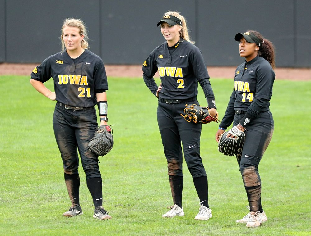 Iowa outfielder Havyn Monteer (21), Aralee Bogar (2), and Nia Carter (14) during the sixth inning of their game against Iowa Softball vs Indian Hills Community College at Pearl Field in Iowa City on Sunday, Oct 6, 2019. (Stephen Mally/hawkeyesports.com)