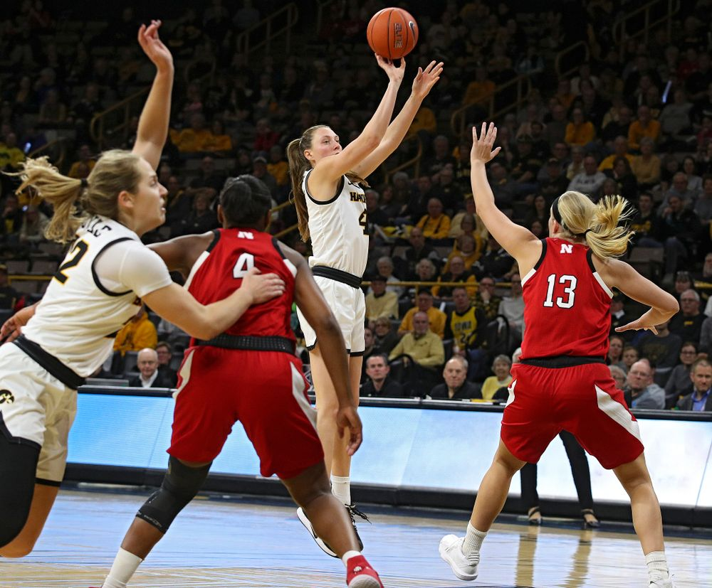 Iowa Hawkeyes forward Amanda Ollinger (43) makes a 3-pointer during the third quarter of the game at Carver-Hawkeye Arena in Iowa City on Thursday, February 6, 2020. (Stephen Mally/hawkeyesports.com)