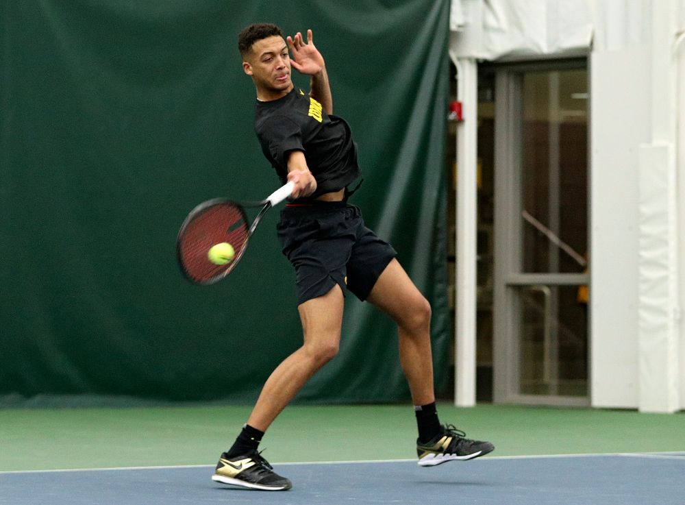 Iowa's Oliver Okonkwo returns a shot during his singles match at the Hawkeye Tennis and Recreation Complex in Iowa City on Friday, February 14, 2020. (Stephen Mally/hawkeyesports.com)