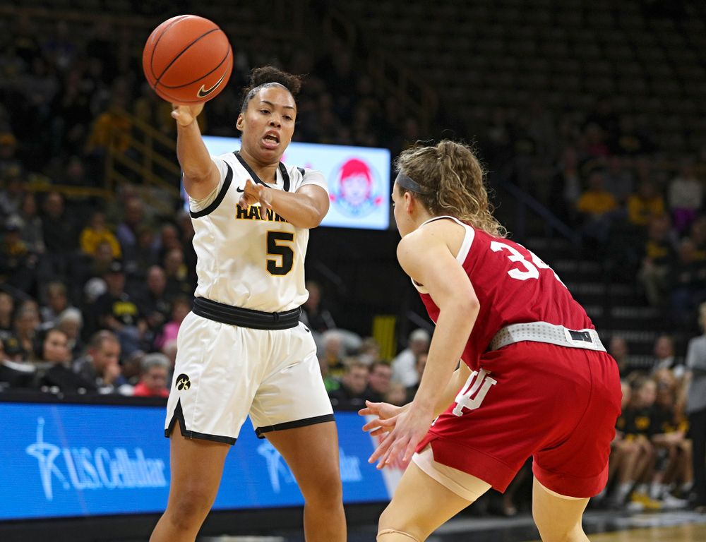 Iowa Hawkeyes guard Alexis Sevillian (5) passes the ball during the first quarter of their game at Carver-Hawkeye Arena in Iowa City on Sunday, January 12, 2020. (Stephen Mally/hawkeyesports.com)