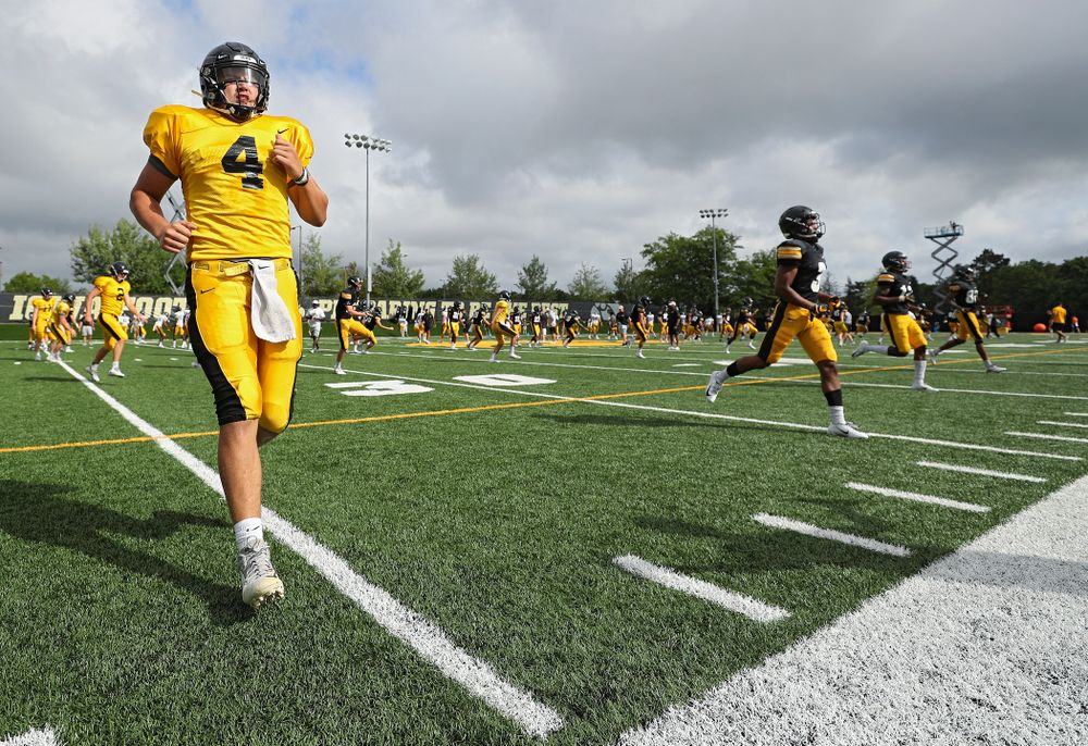 Iowa Hawkeyes quarterback Nate Stanley (4) warms up with his teammates during Fall Camp Practice No. 10 at the Hansen Football Performance Center in Iowa City on Tuesday, Aug 13, 2019. (Stephen Mally/hawkeyesports.com)