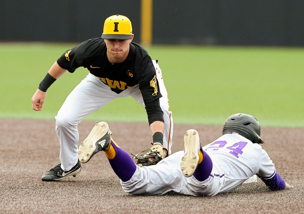 Iowa Hawkeyes shortstop Tanner Wetrich (16) tags out a runner trying to steal during the first inning of their game against Western Illinois at Duane Banks Field in Iowa City on Wednesday, May. 1, 2019. (Stephen Mally/hawkeyesports.com)