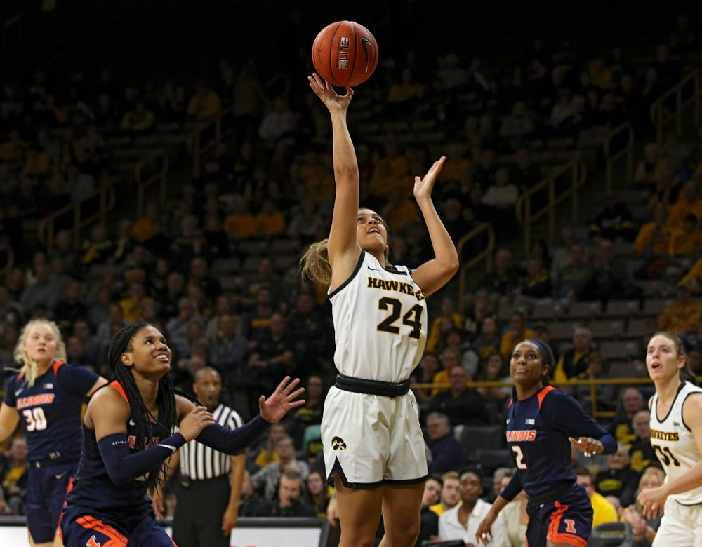 Iowa Hawkeyes guard Gabbie Marshall (24) score a basket during the fourth quarter of their game at Carver-Hawkeye Arena in Iowa City on Tuesday, December 31, 2019. (Stephen Mally/hawkeyesports.com)