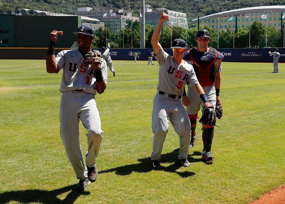 Lorenzo Elion (1), Tyler Cropley (5), and catcher Brett McCleary (32)